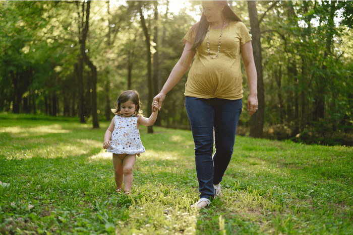 Pregnant Mother walking with her baby